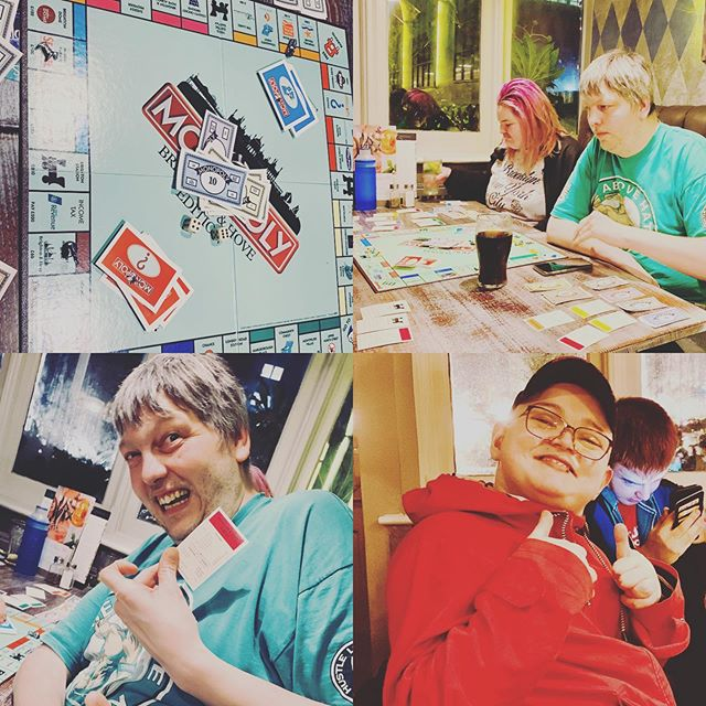 Young people playing Monopoly game