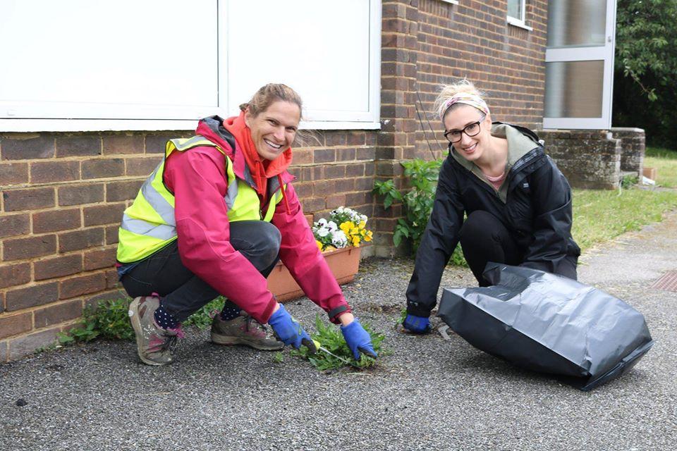 Two females gardening at Portslade Village Centre