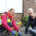 Two females gardening at Portslade Village Centre