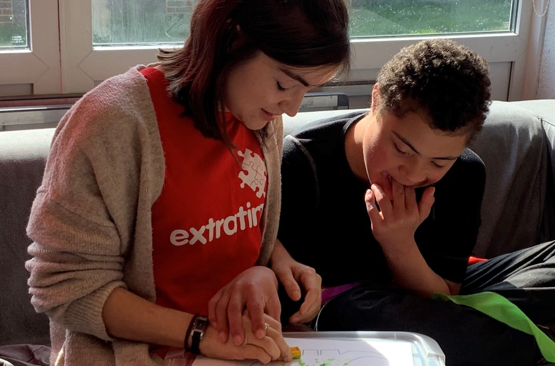 Play Worker and young person painting together
