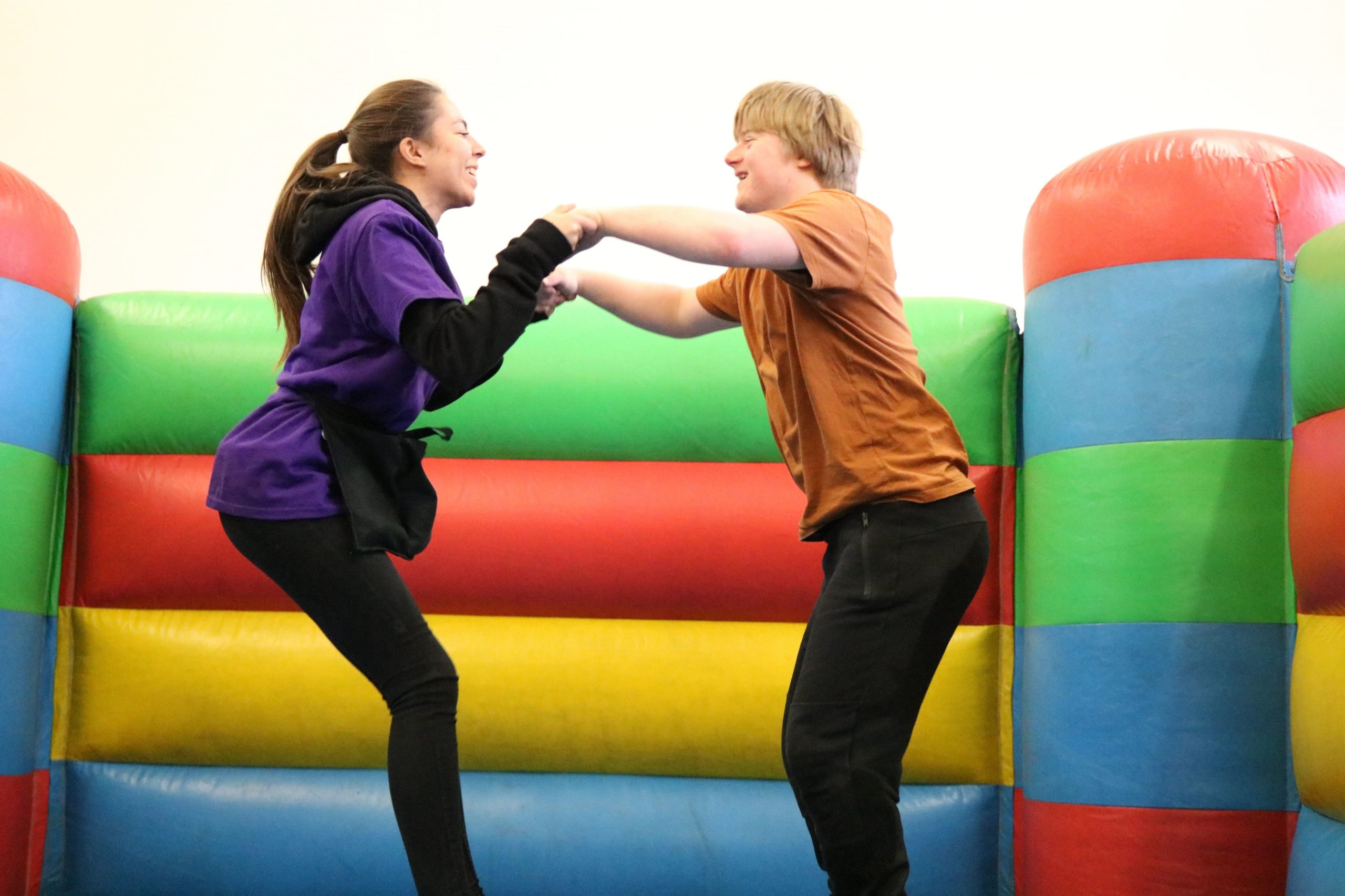 Play Worker and young person on a bouncy castle