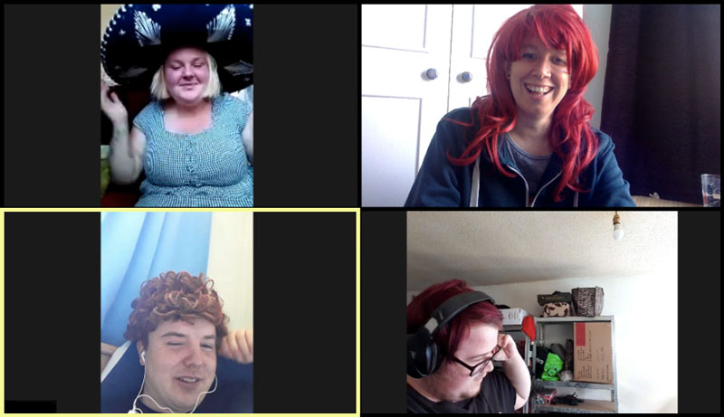 Four people wearing wigs or hats using an online meeting tool